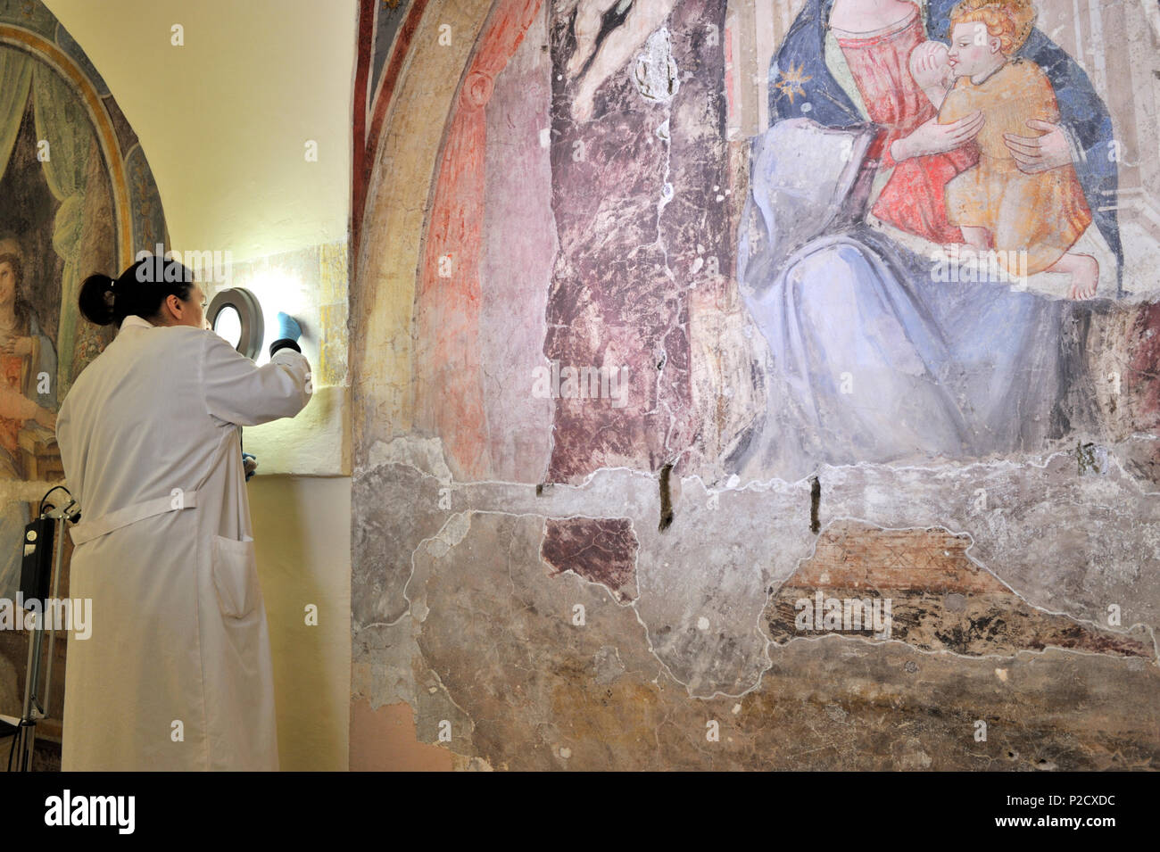 restorations of the frescos (16th century), on the right Madonna del Latte (14th century) in the church of Santa Marta al Collegio Romano, Rome, Italy Stock Photo
