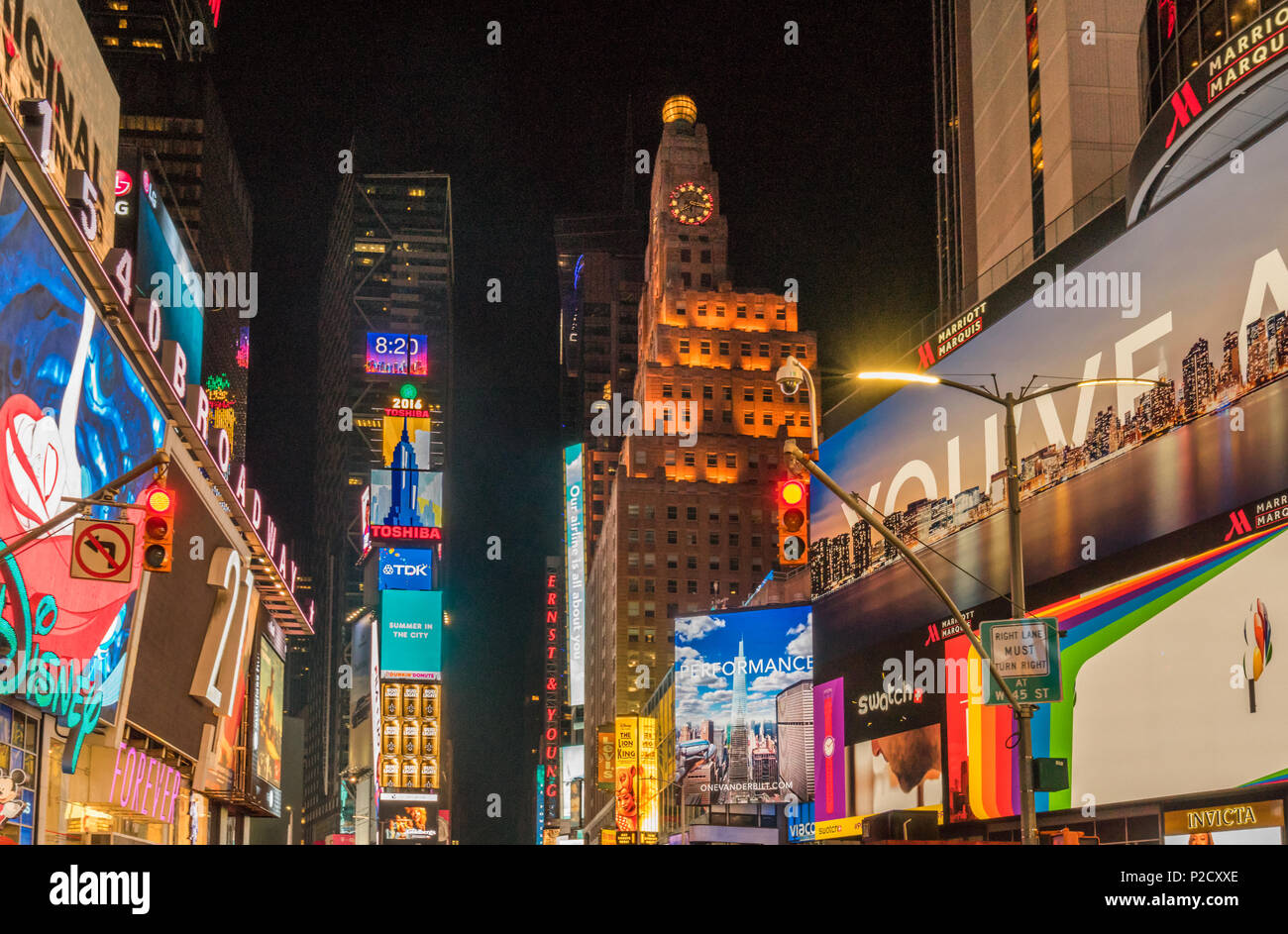 View of the animated and illuminated advertising screens at night in Times Square, Manhattan, New York City Stock Photo