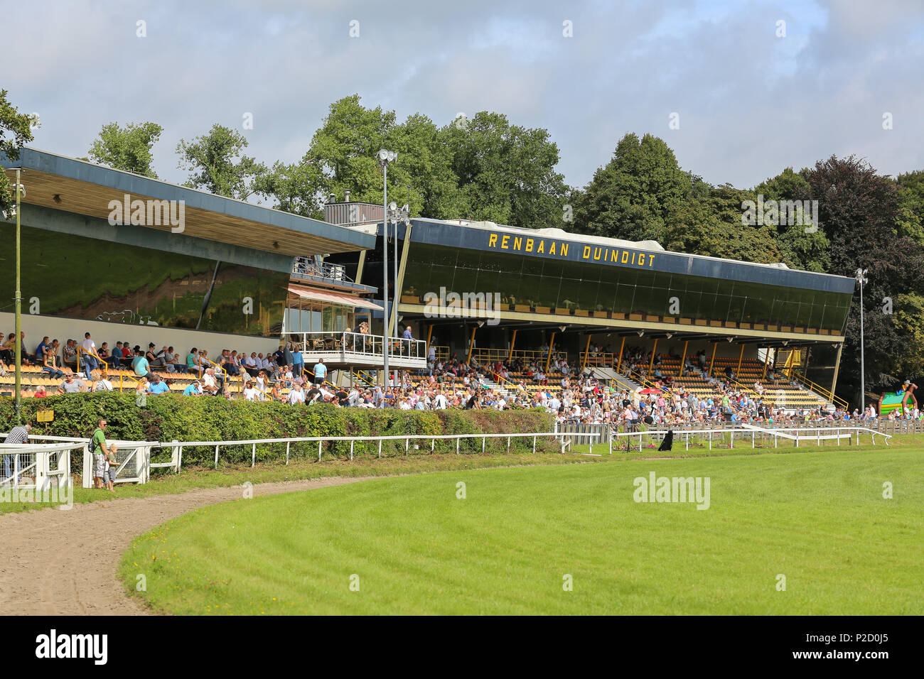 WASSENAAR, THE NETHERLANDS - AUGUST 28, 2016:  Horse race track Duindigt at derby day with crowd at the stands ready to place their bets. - Stock Image