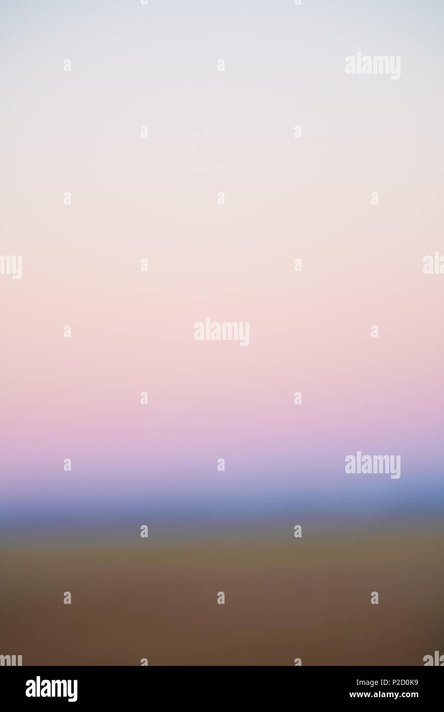Color of sunrise over land changing abstract background image. - Stock Image