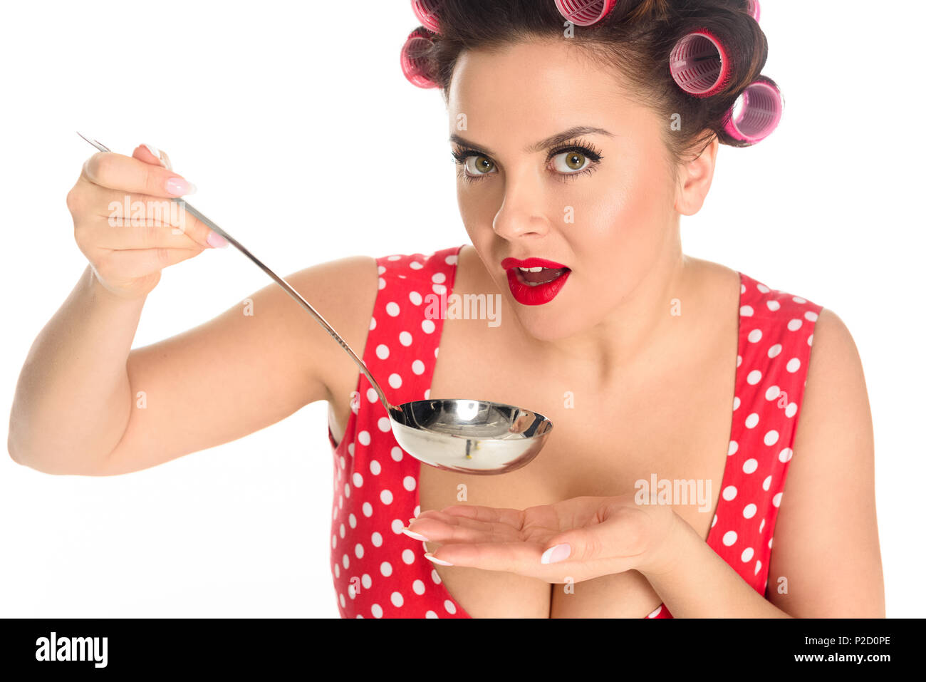 close-up portrait of emotional plus size housewife cooking with ladle isolated on white - Stock Image
