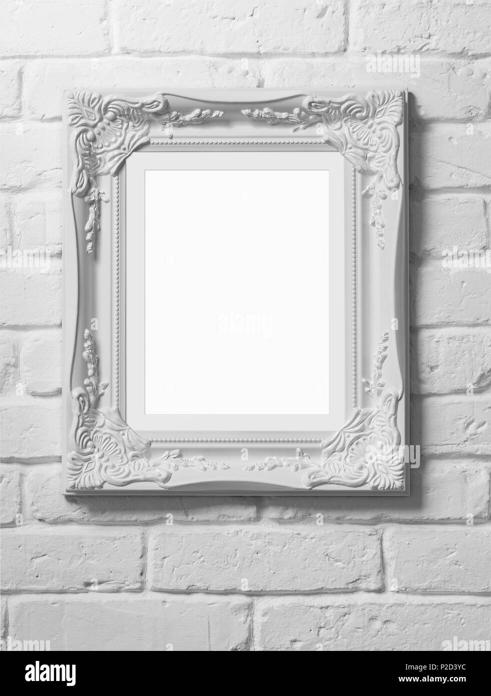 Close up of blank picture frame at the brick wall with clipping path - Stock Image