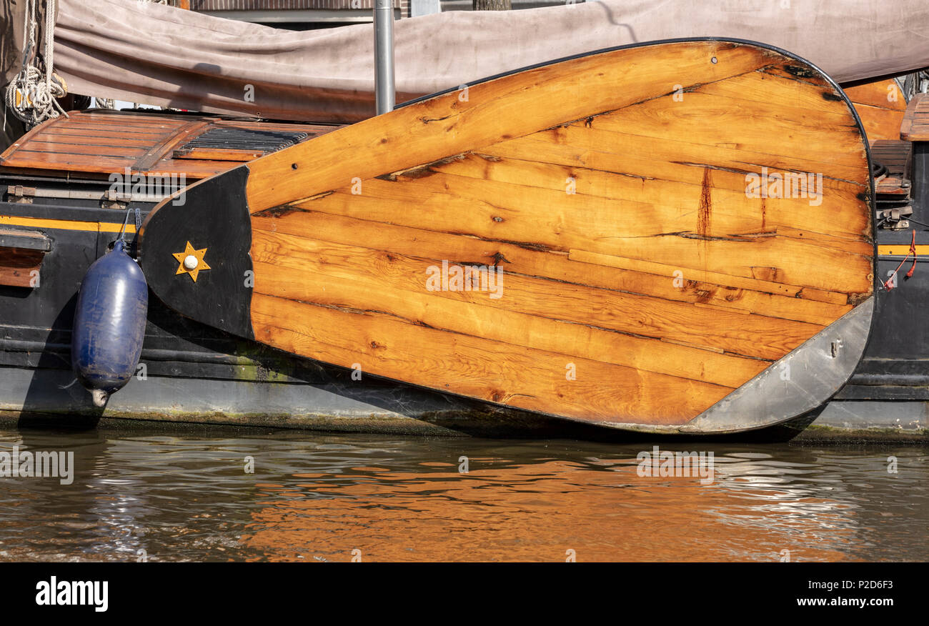 Wooden stabilizer for houseboat, Prinsengracht, Amsterdam, Netherlands - Stock Image