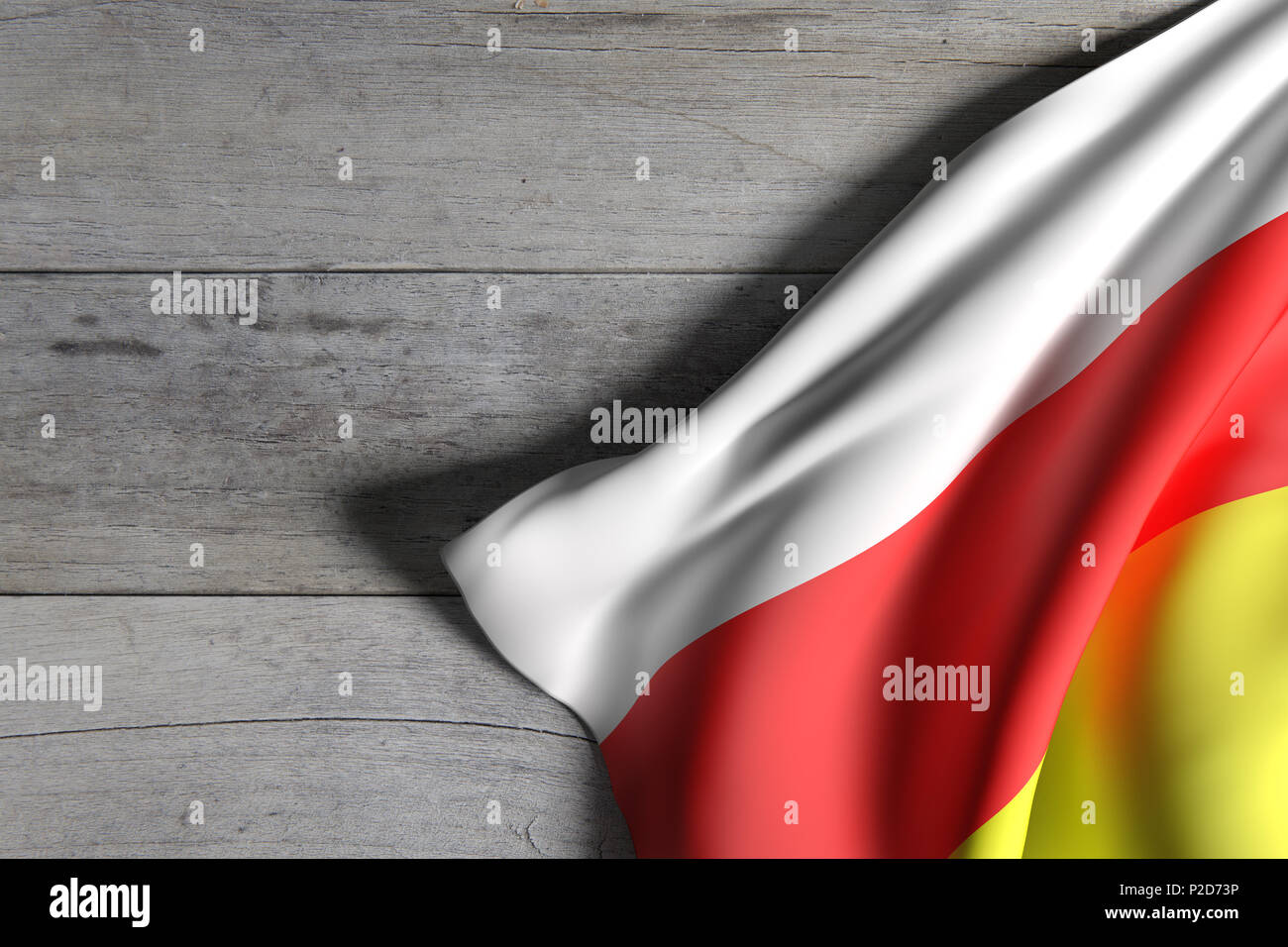 3d rendering of South Ossetia flag over a wooden surface - Stock Image