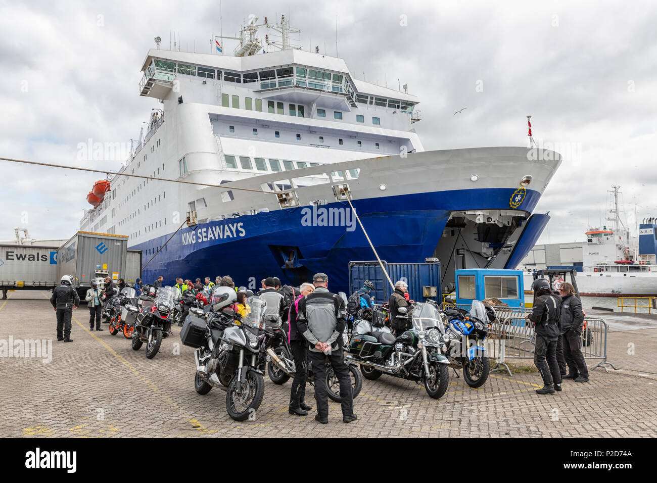 Ferry in Dutch harbor IJmuiden with motorcyclists waiting to embark. - Stock Image