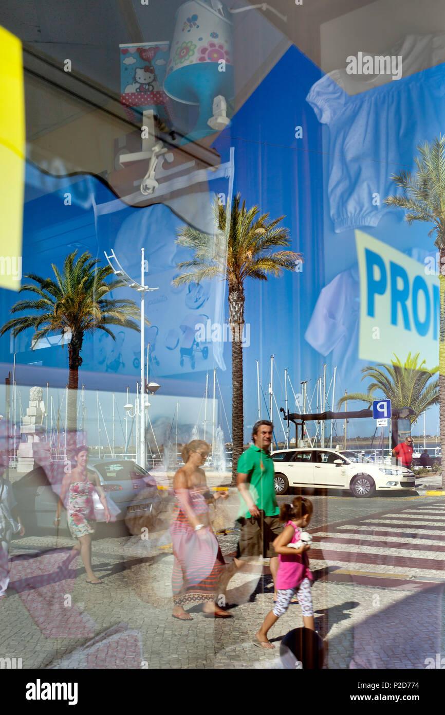 Reflection in a shop window, Vila Real de Santo Antonio, Algarve, Portugal - Stock Image