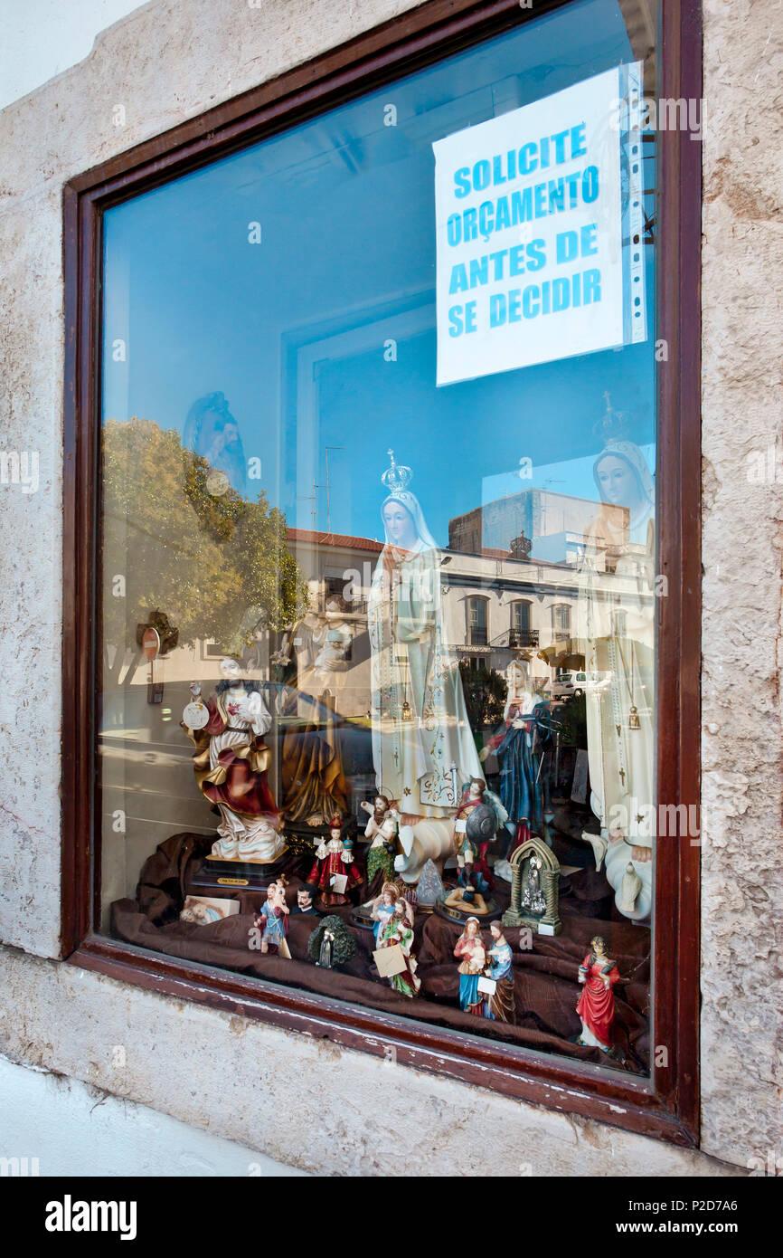 Reflection in a shop window, Tavira, Algarve, Portugal - Stock Image
