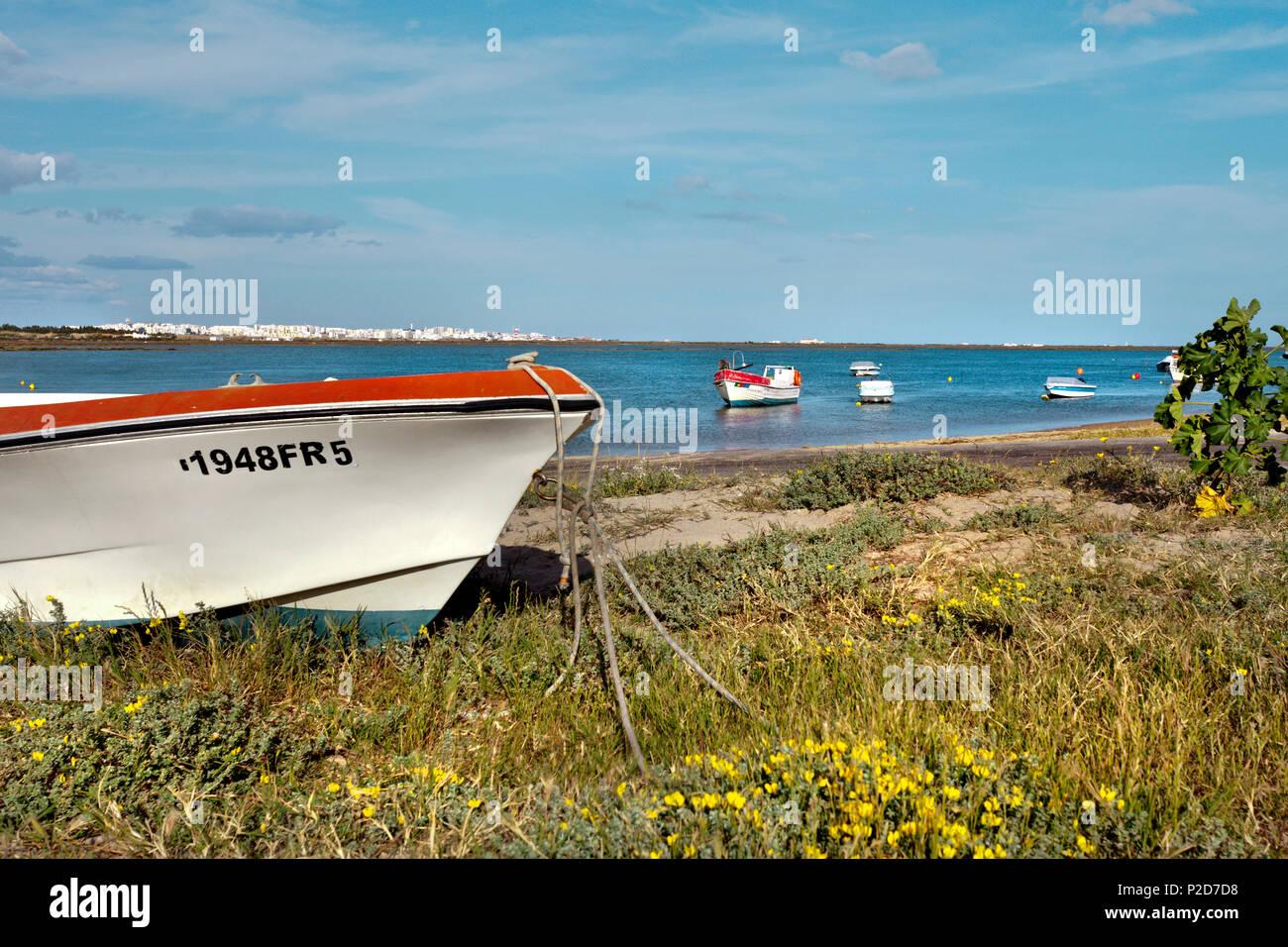 Boat on the beach, lagoon, Praia de Faro, Faro, Algarve, Portugal - Stock Image