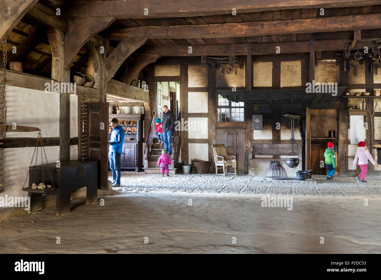 LWL-Open-Air Museum Detmold, visitors in the stable and farmhouse, traditional buildings, frame house, village, Detmold, North R - Stock Image