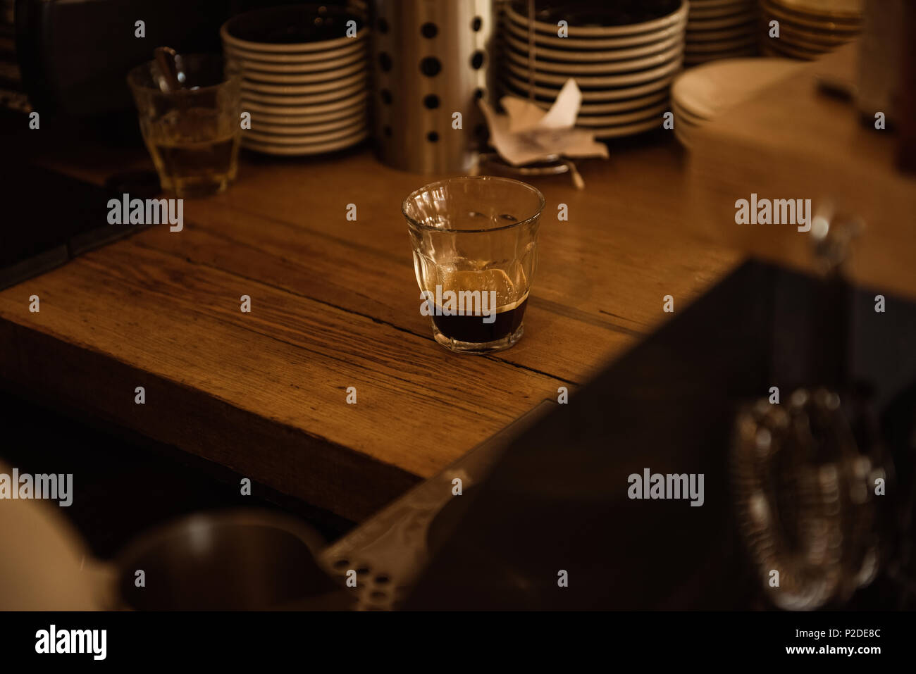 Empty glass on wooden table - Stock Image