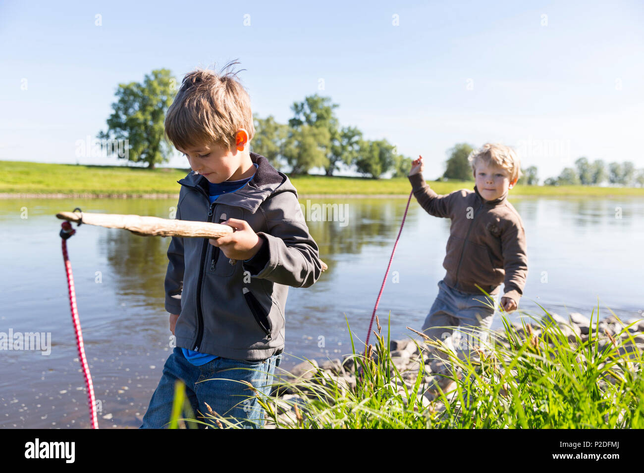 Boys fishing, Family bicycle tour along the river Elbe, adventure, from Torgau to Riesa, Saxony, Germany, Europe Stock Photo