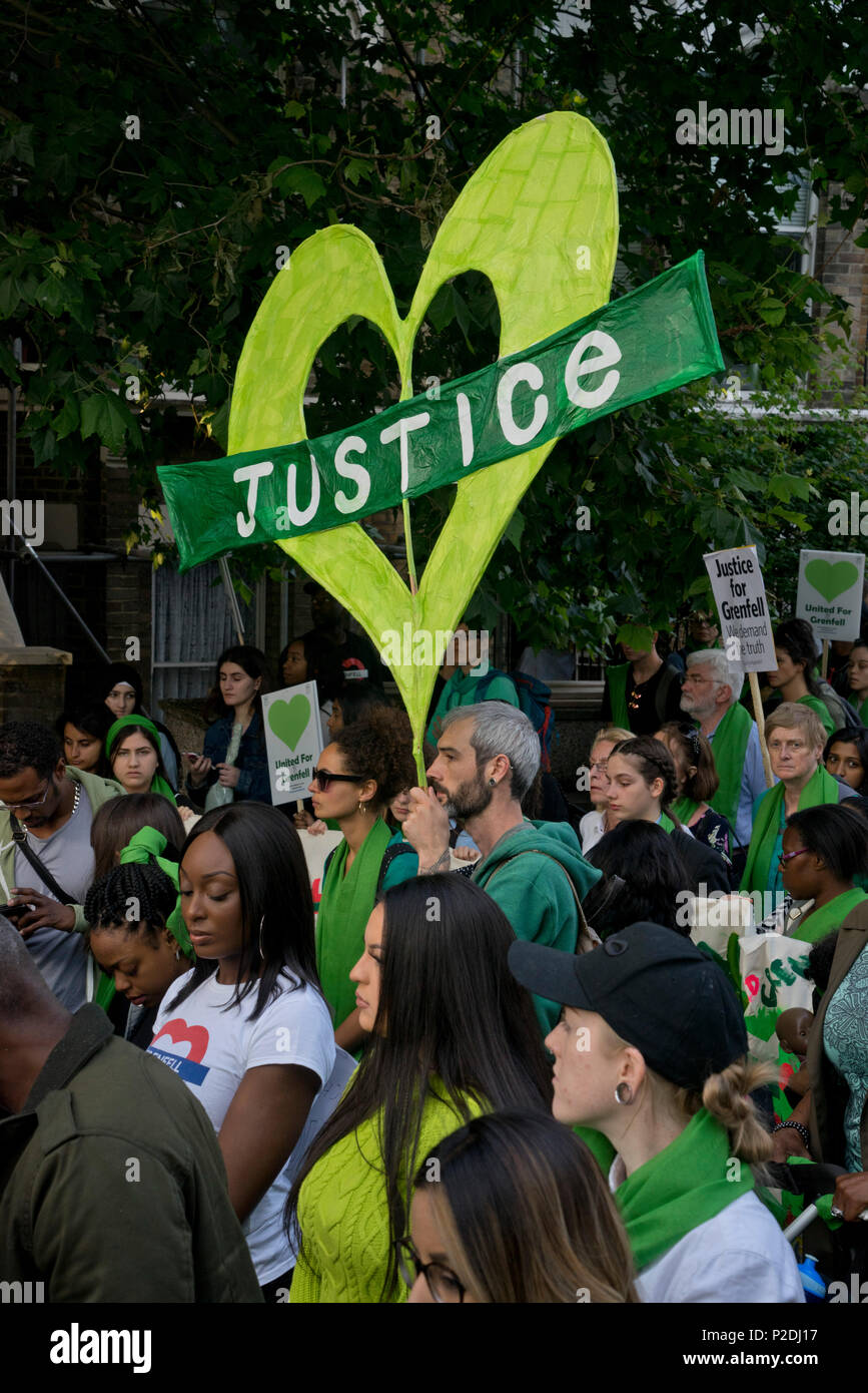 Silent march and vigil to commemorate the first anniversary of the Grenfell Tower fire disaster in North London,UK - Stock Image