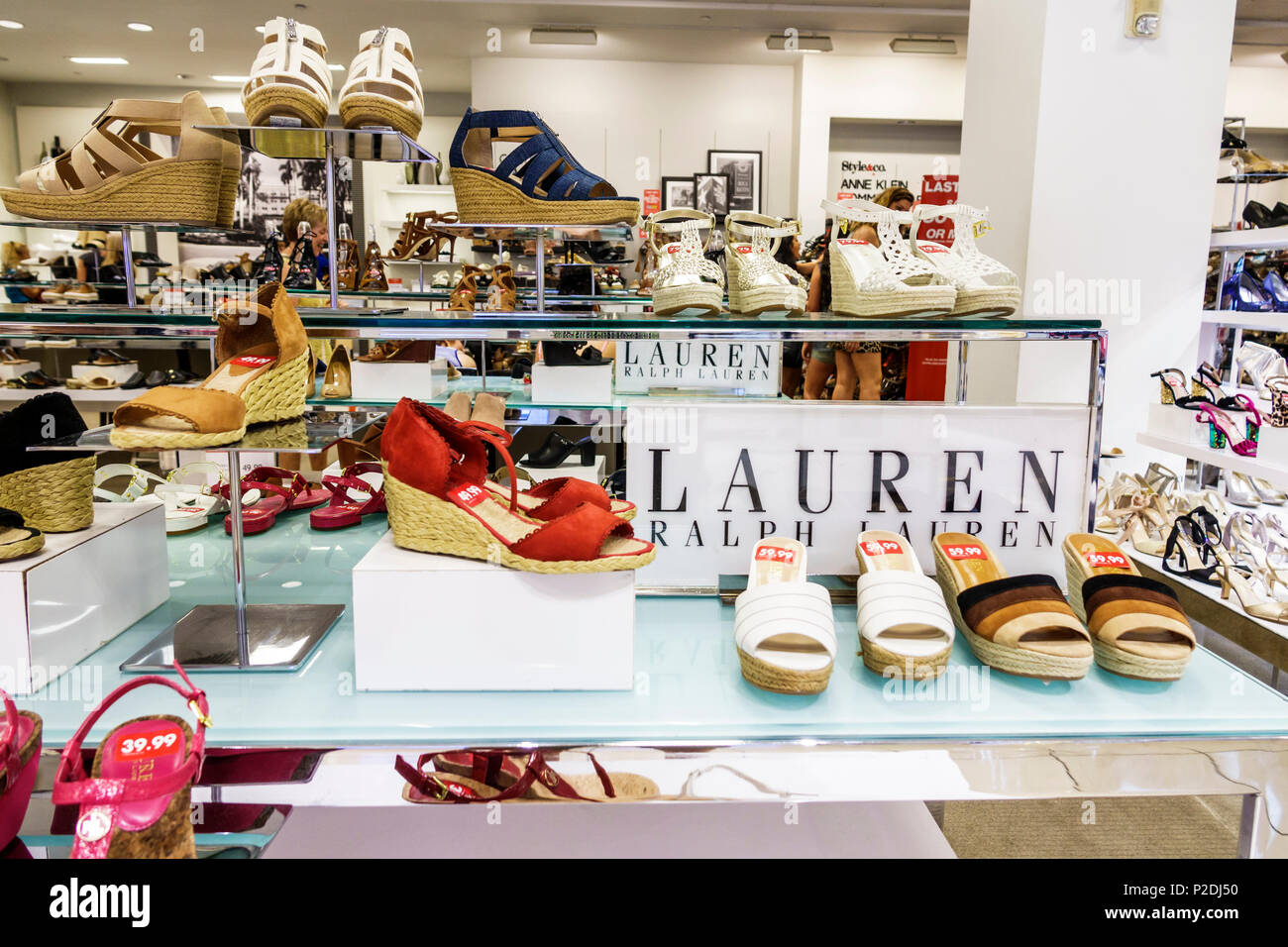 Florida Jensen Beach Macy's Department Store inside shopping women's shoes Ralph Lauren designer brand sandals wedges sale display - Stock Image