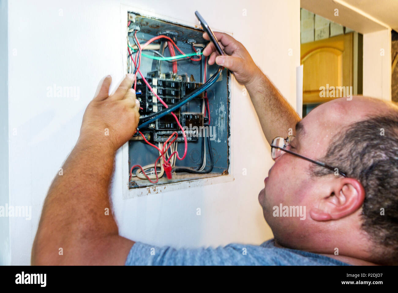 Electrical Panel Circuit Breakers Stock Photos Home Wiring Breaker Box Florida Miami Beach Hispanic Man Electrician Working Wires Job Repair