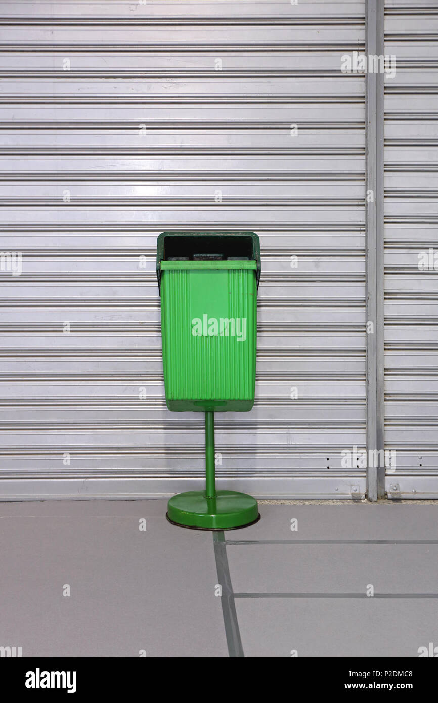 Stand Alone Green Plastic Public Trash Can - Stock Image
