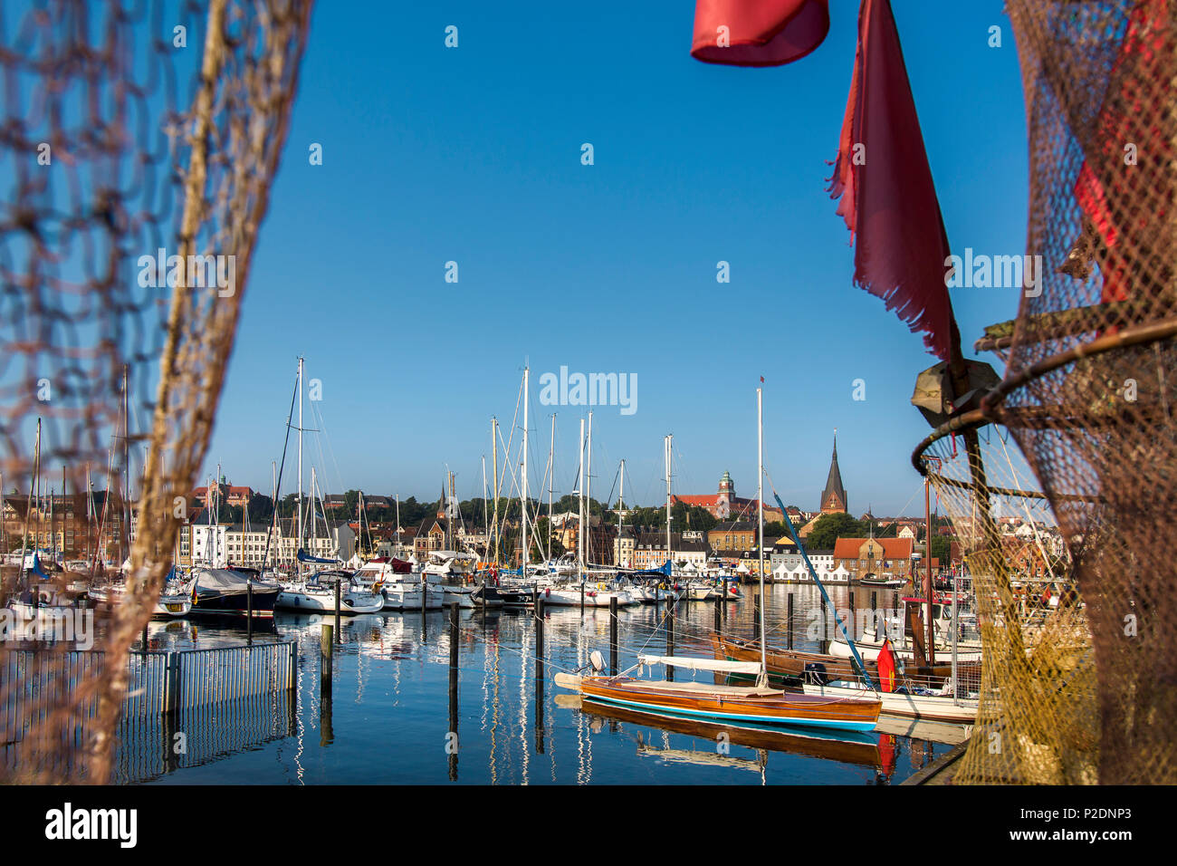 View through a fishing net towards the old town, Flensburg, Baltic Coast, Schleswig-Holstein, Germany - Stock Image