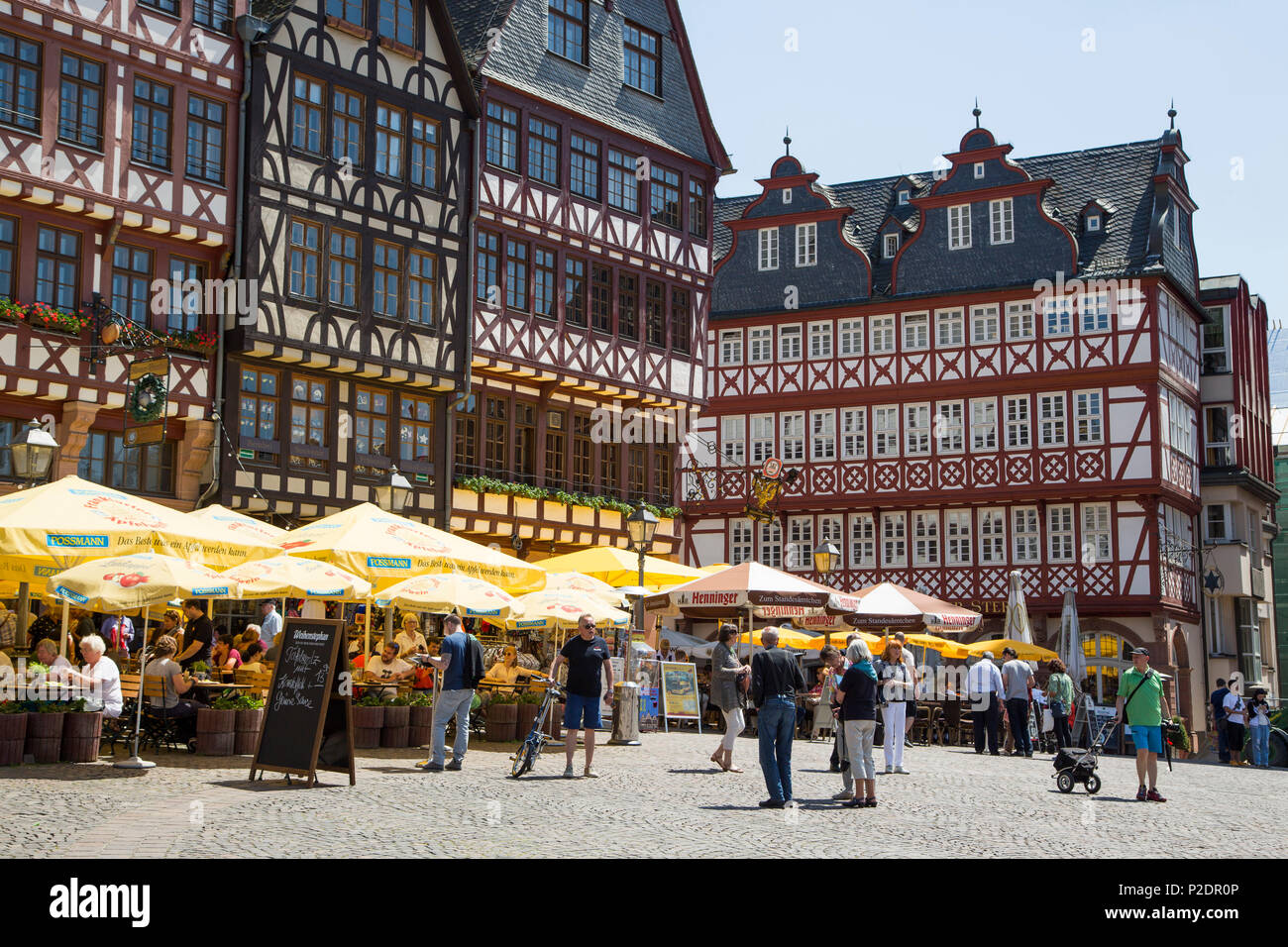Half-timbered buildings with outdoor seating at restaurants on Roemerberg square, Frankfurt am Main, Hessen, Germany, Europe - Stock Image