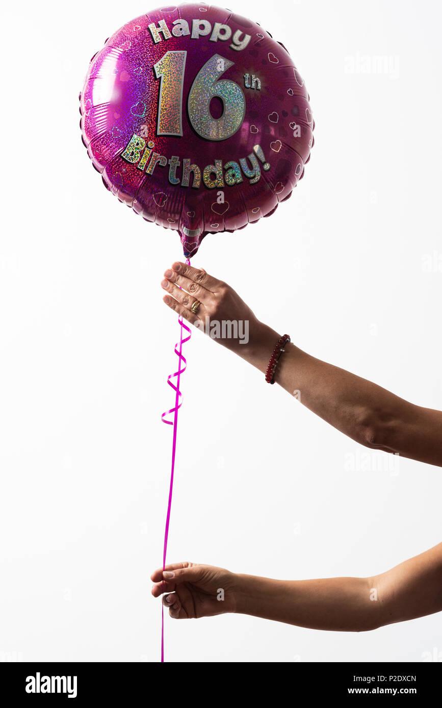 Celebration-helium balloon-happy sixteen birthday - Stock Image