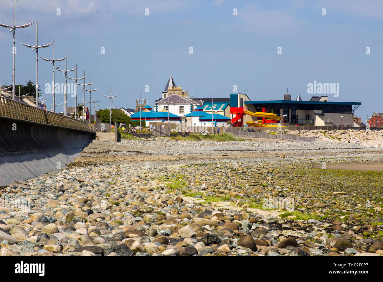7 June 2018 The pebble beach beneath the new Promenade breakwater at Newcastle in County Down Northern Ireland on a hot summer day. - Stock Image