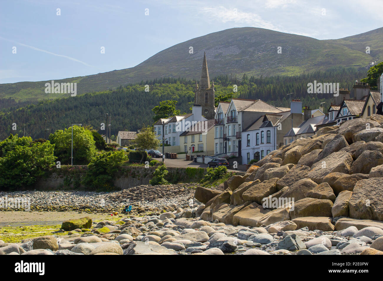 7 June 2018 A view of the Mountains of Mourne from the stony beach at  the Kilkeel Road in Newcastle County Down  Northern Ireland - Stock Image