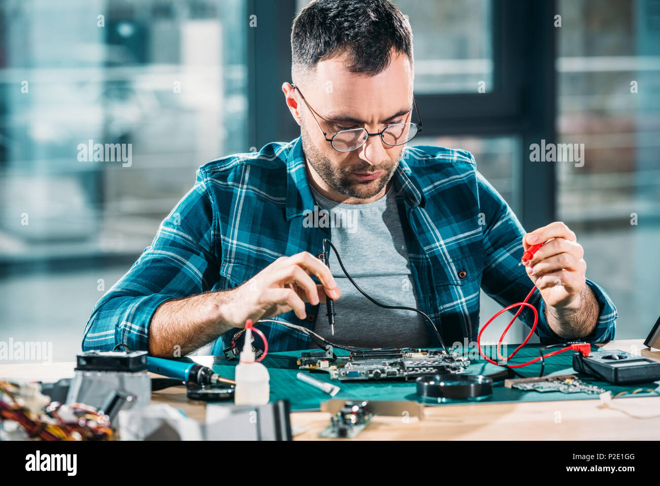 Repairman Testing Circuit Board With Multimeter Stock Photo Electronics Test For A Series Including Voltmeter