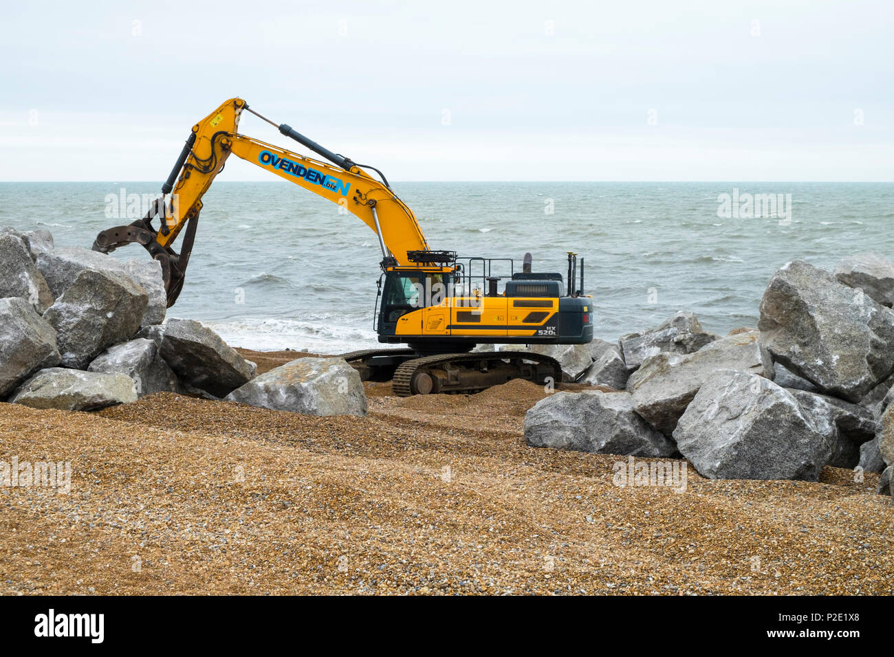 Stockpiling of 6-9 tonne rock for the Hastings coast protection works, harbour arm, hastings, east sussex, uk - Stock Image