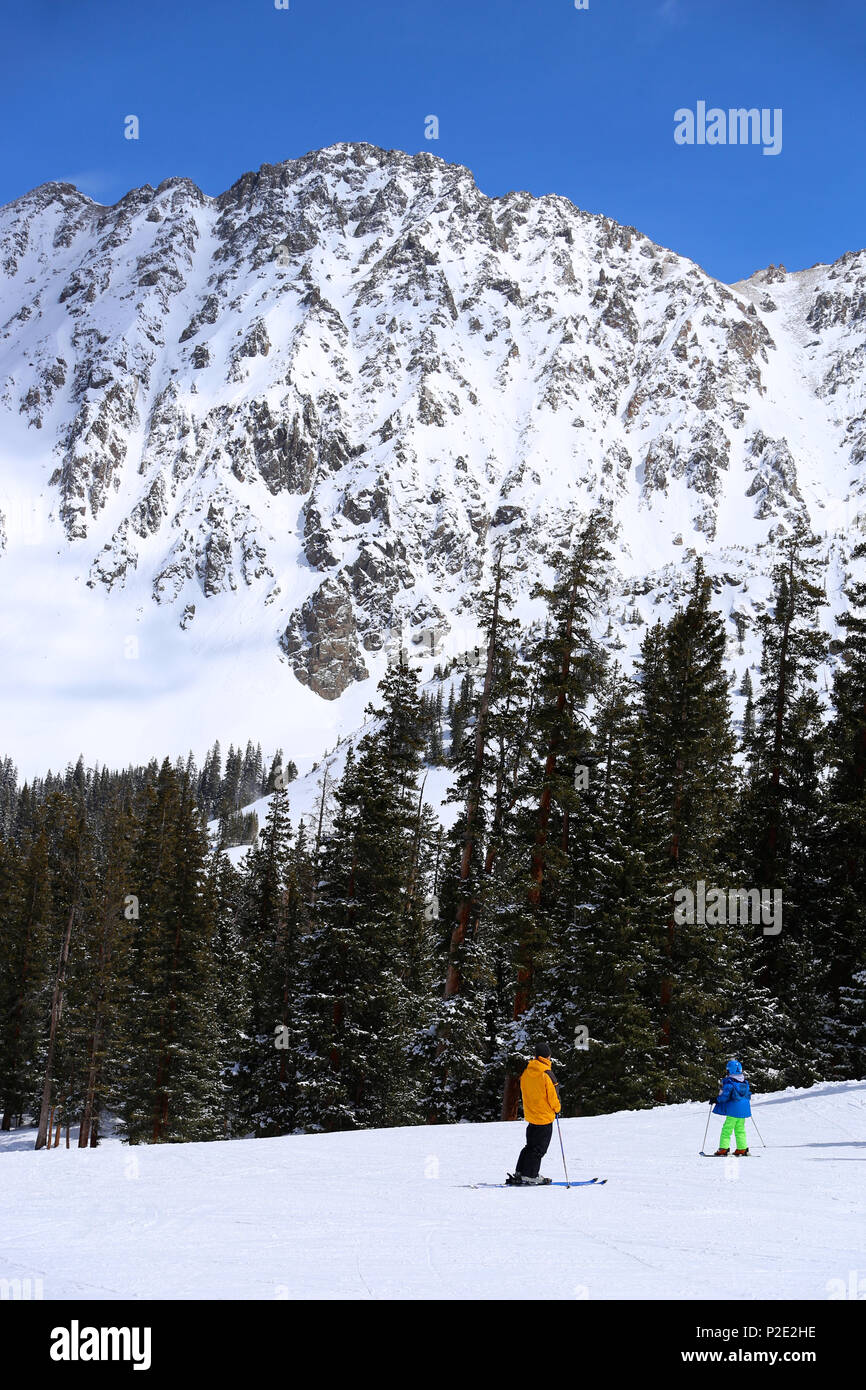 People skiing at Arapahoe Basin Ski Resort in the Colorado Rocky Mountains - Stock Image