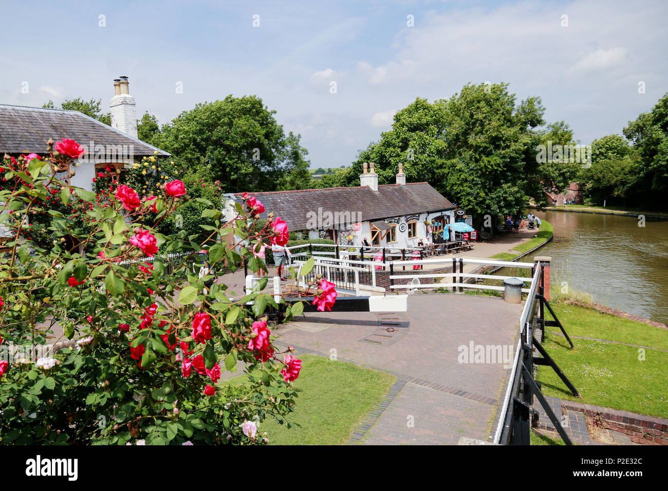 Canalside shops and pubs at Foxton Locks - Stock Image