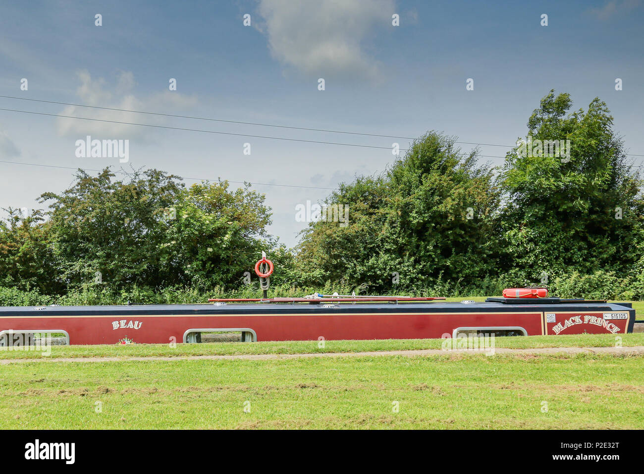 A narrow boat ascending from the depths of a lock at Foxton Locks - Stock Image
