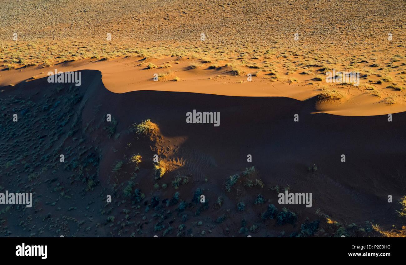 Sand dune in half shadow - Stock Image
