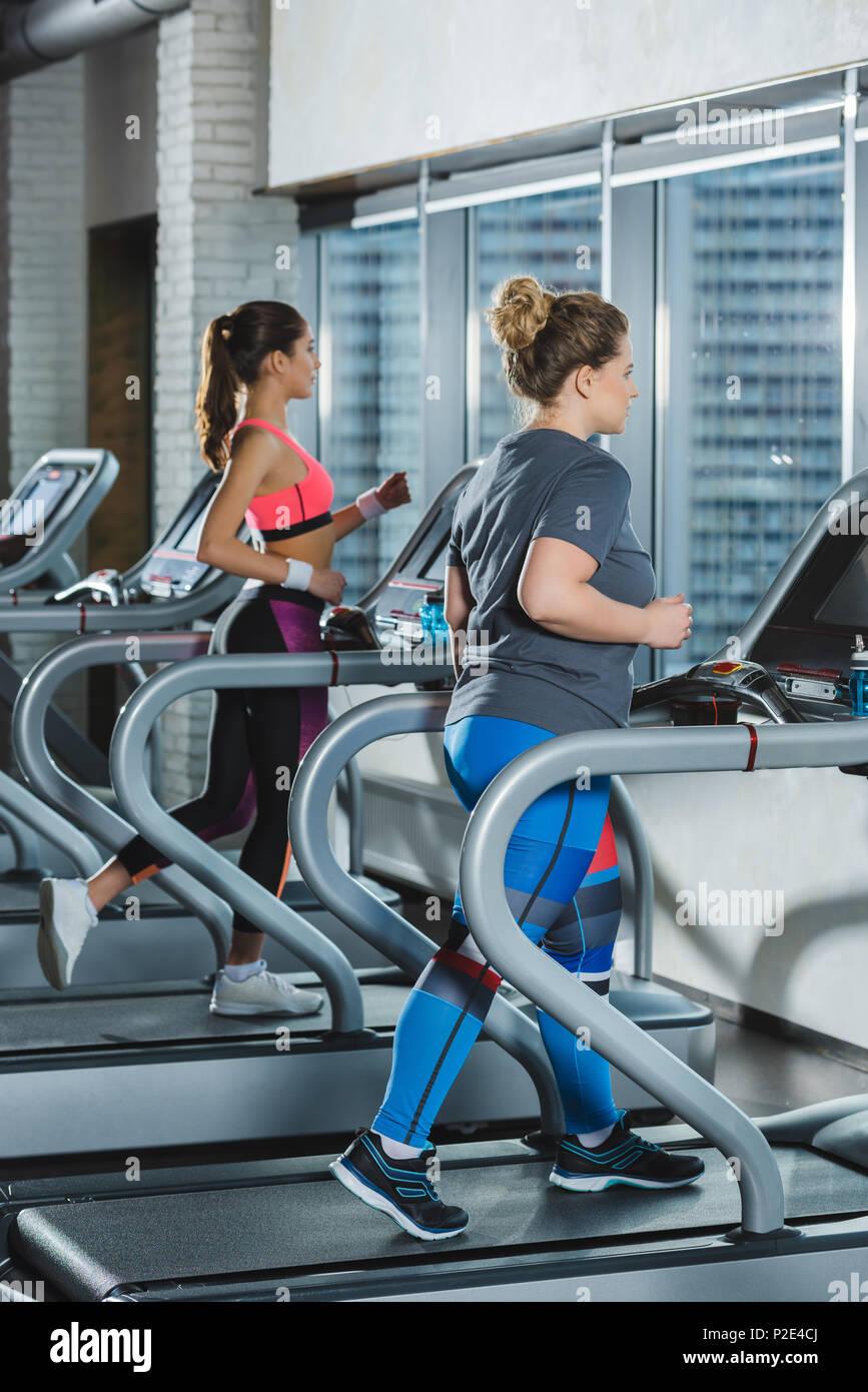 women training on treadmills at gym - Stock Image