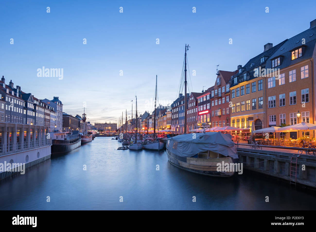 Nyhavn with the canal at night in Copenhagen city, Denmark. - Stock Image