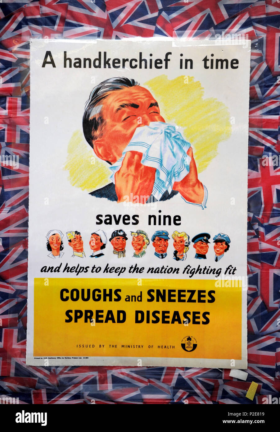Wartime poster 'A handkerchief in Time saves Nine', Coughs and Sneezes Spread Diseases' - Stock Image