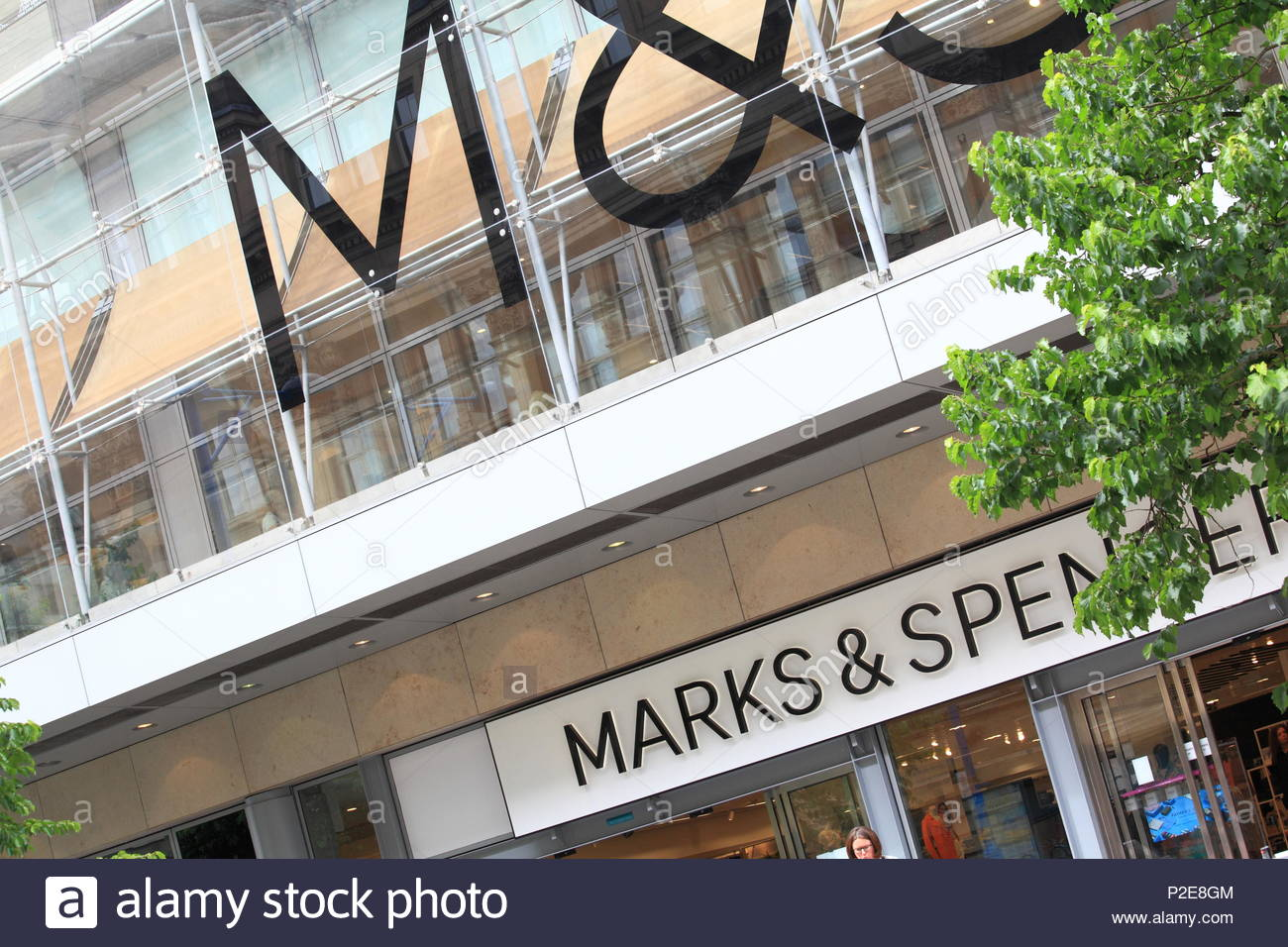 Modern attractive signage to the store front of the Marks & Spencer Store at Manchester City Centre Uk Summer June 2018 - Stock Image