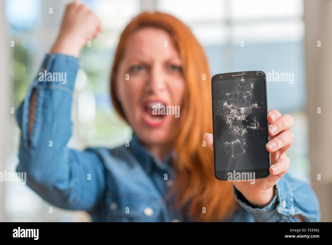 Angry woman breaks annoying womans phone