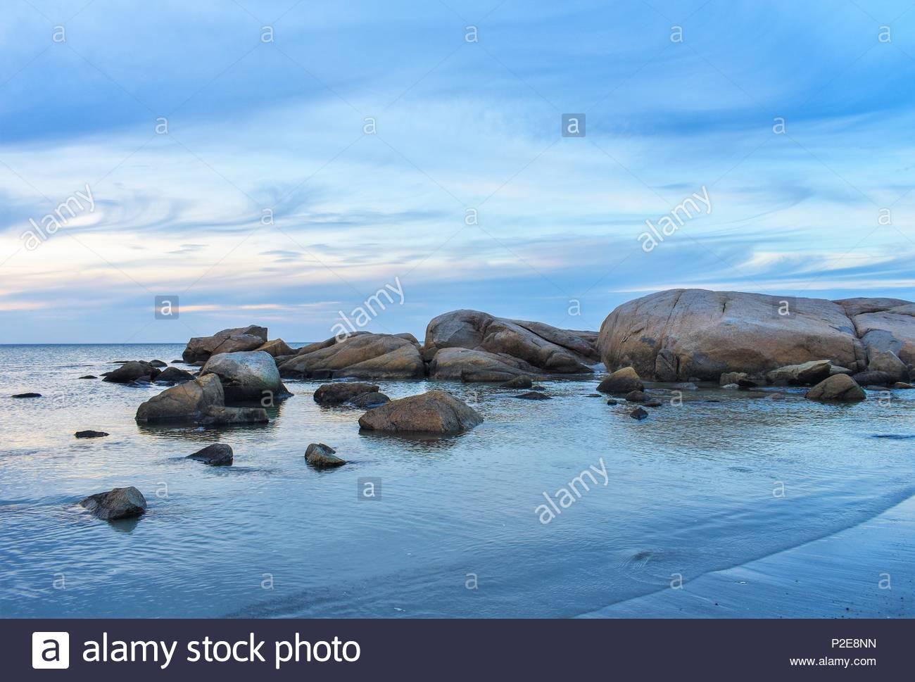 Stillness on the Rocky Shores of Wingaersheek Beach, Gloucester, MA USA - Stock Image