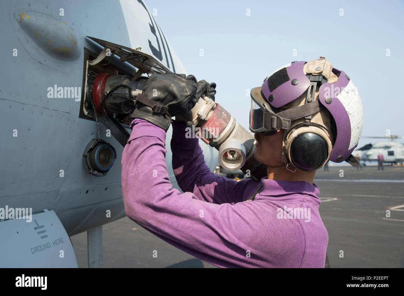 160913-N-CZ759-014    ARABIAN GULF (Sept. 13, 2016) Aviation Boatswain's Mate (Fuels) Airman Blane Davidson, from Orlando, Fla., refuels an F/A-18C Hornet assigned to the Wildcats of Strike Fighter Squadron (VFA) 131 on the flight deck of the aircraft carrier USS Dwight D. Eisenhower (CVN 69) (Ike). Ike and its Carrier Strike Group are deployed in support of Operation Inherent Resolve, maritime security operations and theater security cooperation efforts in the U.S. 5th Fleet area of operations. (U.S. Navy photo by Mass Communication Specialist 3rd Class Theodore Quintana) - Stock Image