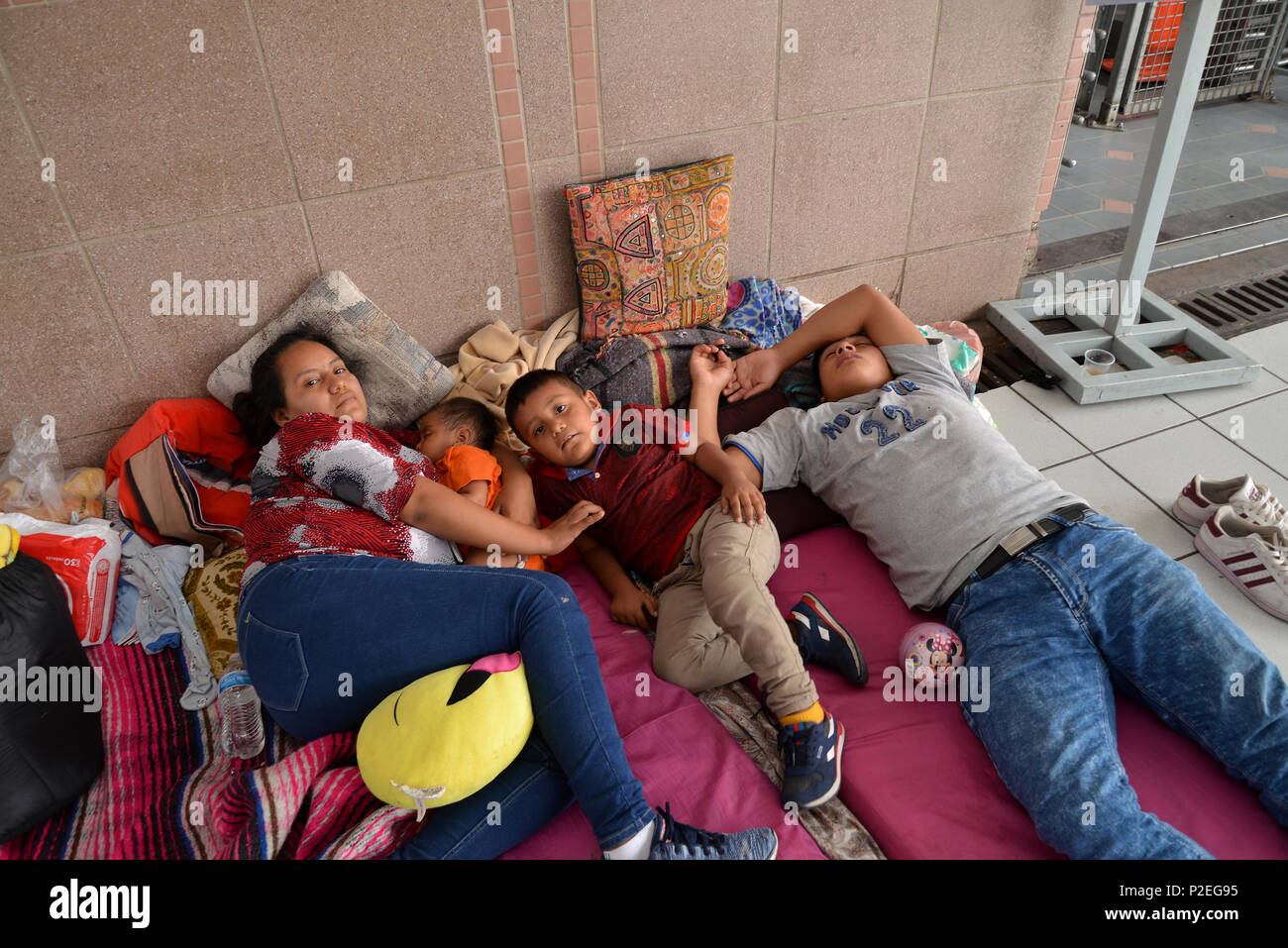 Families from Guatemala and Mexico seeking asylum in the United States wait for many days at the port-of-entry in Nogales, Sonora, Mexico for US offic Stock Photo