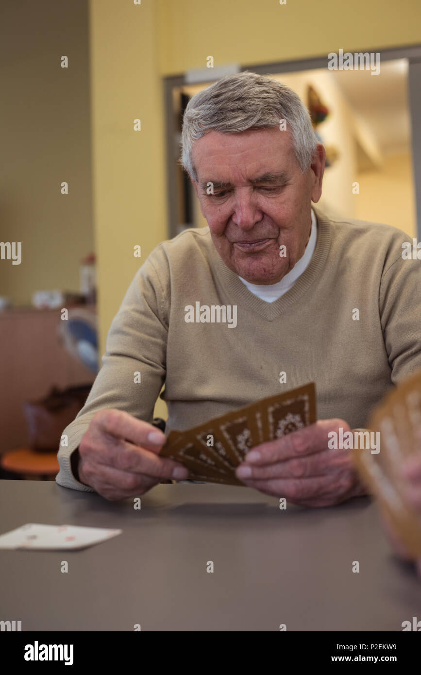 Senior man playing cards - Stock Image