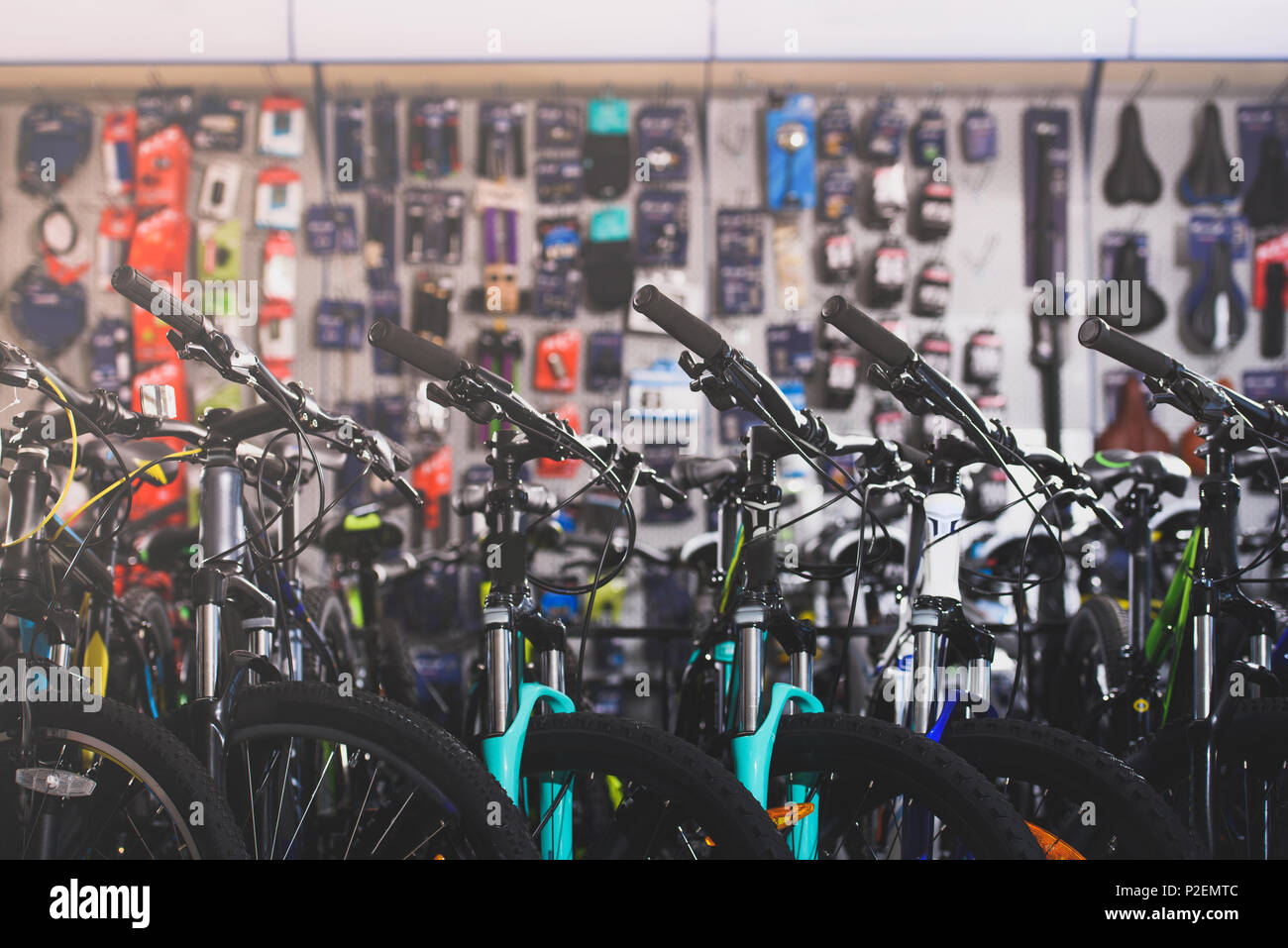 various modern bikes selling in bicycle shop - Stock Image