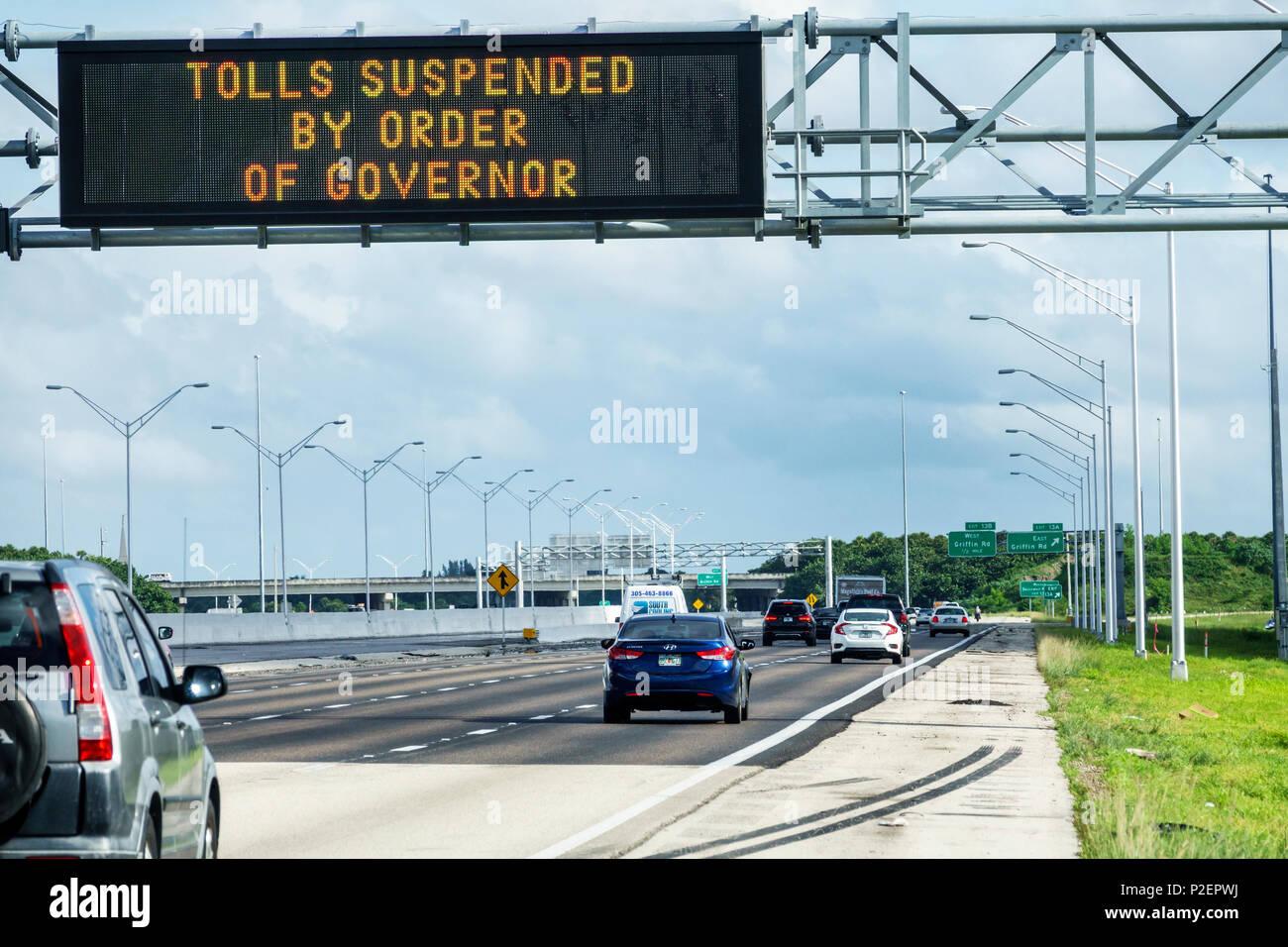 Florida Miami Hurricane Irma approaching preparation Interstate I-75 I75 electronic sign evacuation tolls suspended order governor highway traffic evacuating cars - Stock Image