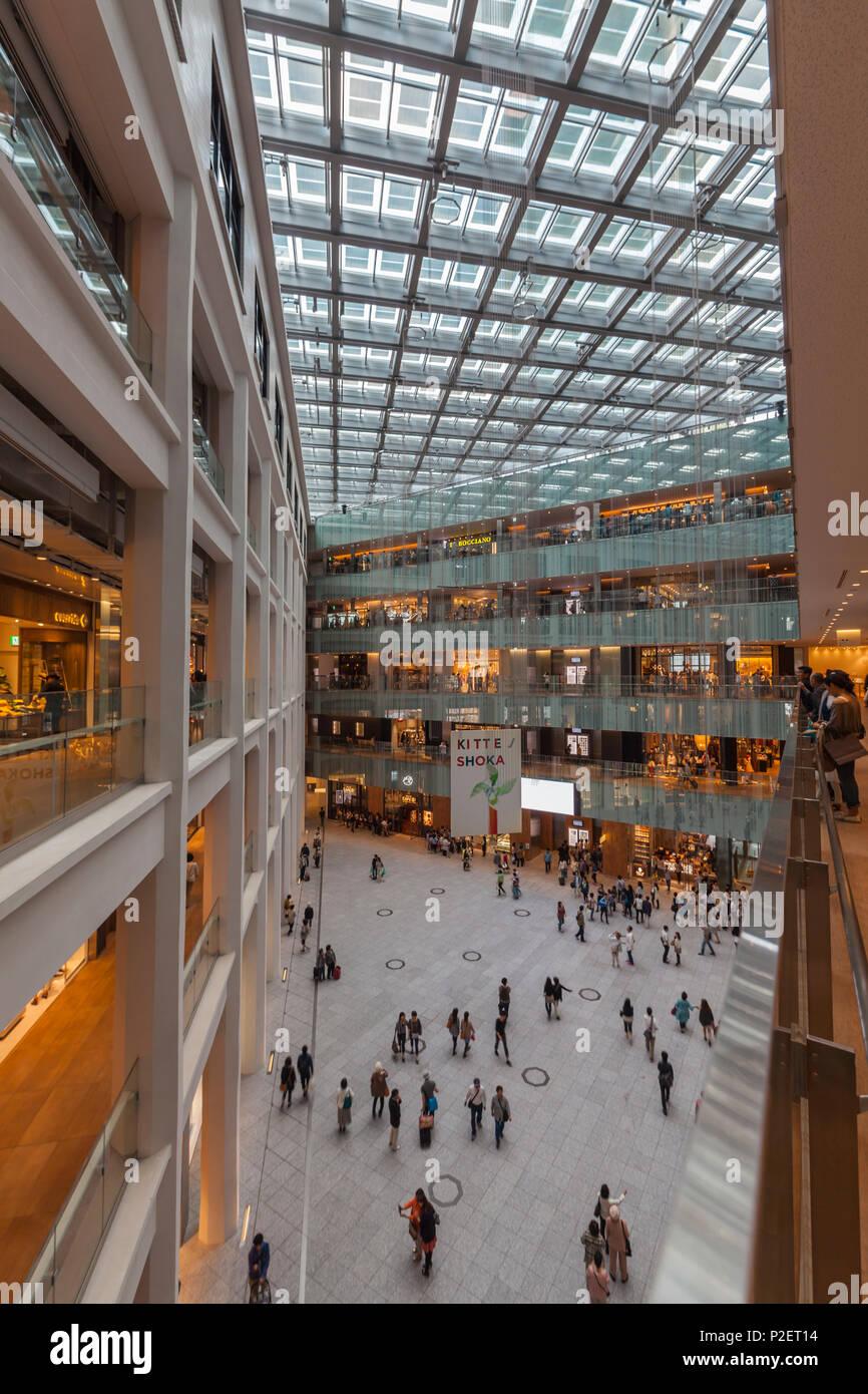 Atrium inside JP Tower, Chuo-ku, Tokyo, Japan Stock Photo