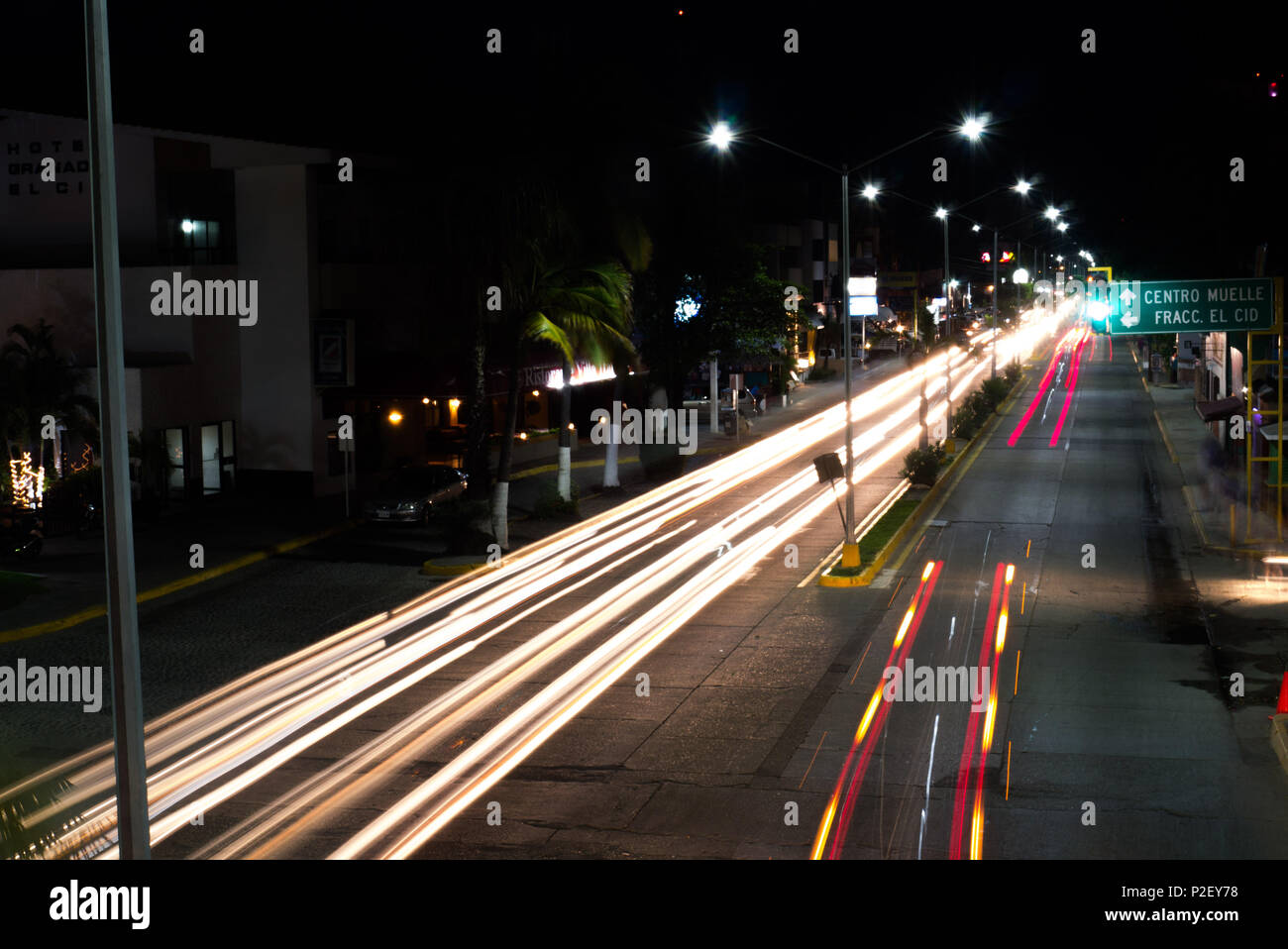 Traffic passing by at night - Stock Image