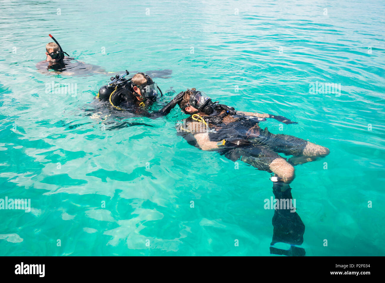 Members of Underwater Construction Team (UCT) 2 perform surface checks in Kwajalein, Marshal Islands while participating in Valiant Shield Sep. 15, 2016. Valiant Shield is a biennial U.S. Air Force, Navy and Marine Corps exercise held in and around Guam, focusing on real-world proficiency in sustaining joint forces at sea, in the air, on land and in cyberspace. (U.S. Navy Combat Camera Photo by Mass Communication Specialist 2nd Class Daniel Rolston/Released) Stock Photo