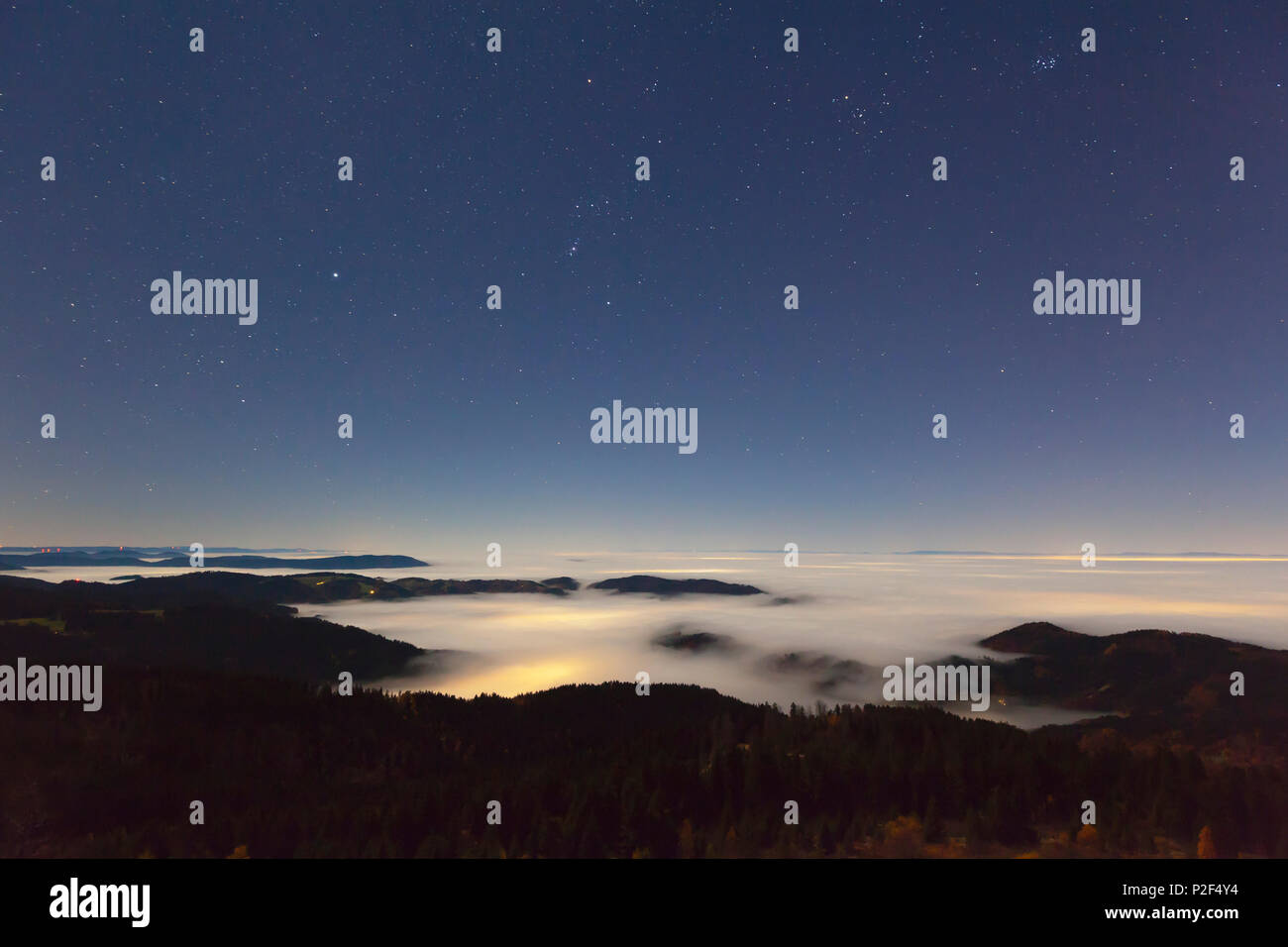 Starry sky over fog in the Rhine valley, view from Schwarzwaldhochstrasse, Black Forest, Baden-Wuerttemberg, Germany Stock Photo