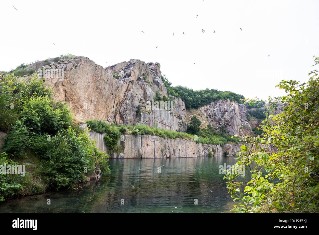 stone quarry Hammerso, lake and climbing area, Baltic sea, Bornholm, near Sandvig, Denmark, Europe Stock Photo