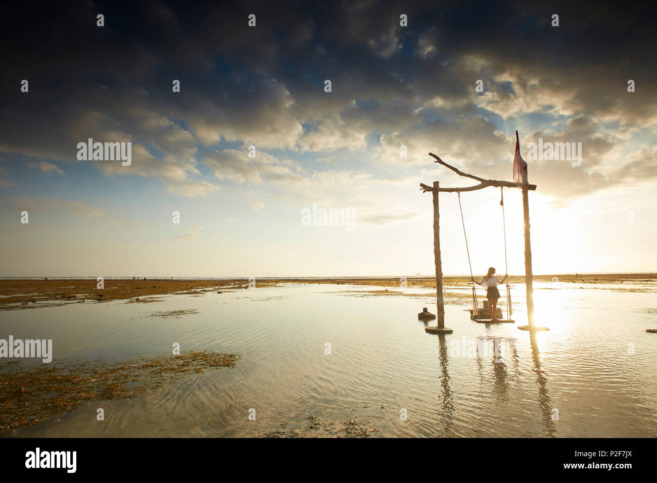 Beach swing at low tide, Gili Trawangan, Lombok, Indonesia - Stock Image