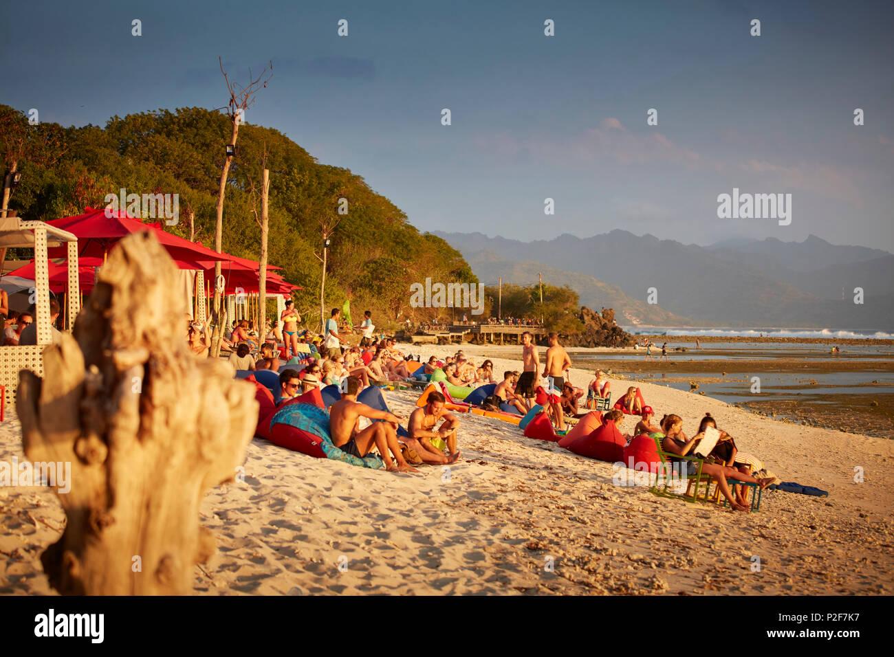 Guests in a beach bar, Gili Trawangan, Lombok, Indonesia - Stock Image