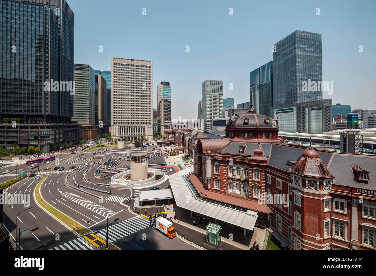 Tokyo Station with skyscrapers in background and blue sky seen from JP Tower, Chiyoda-ku, Tokyo, Japan - Stock Image