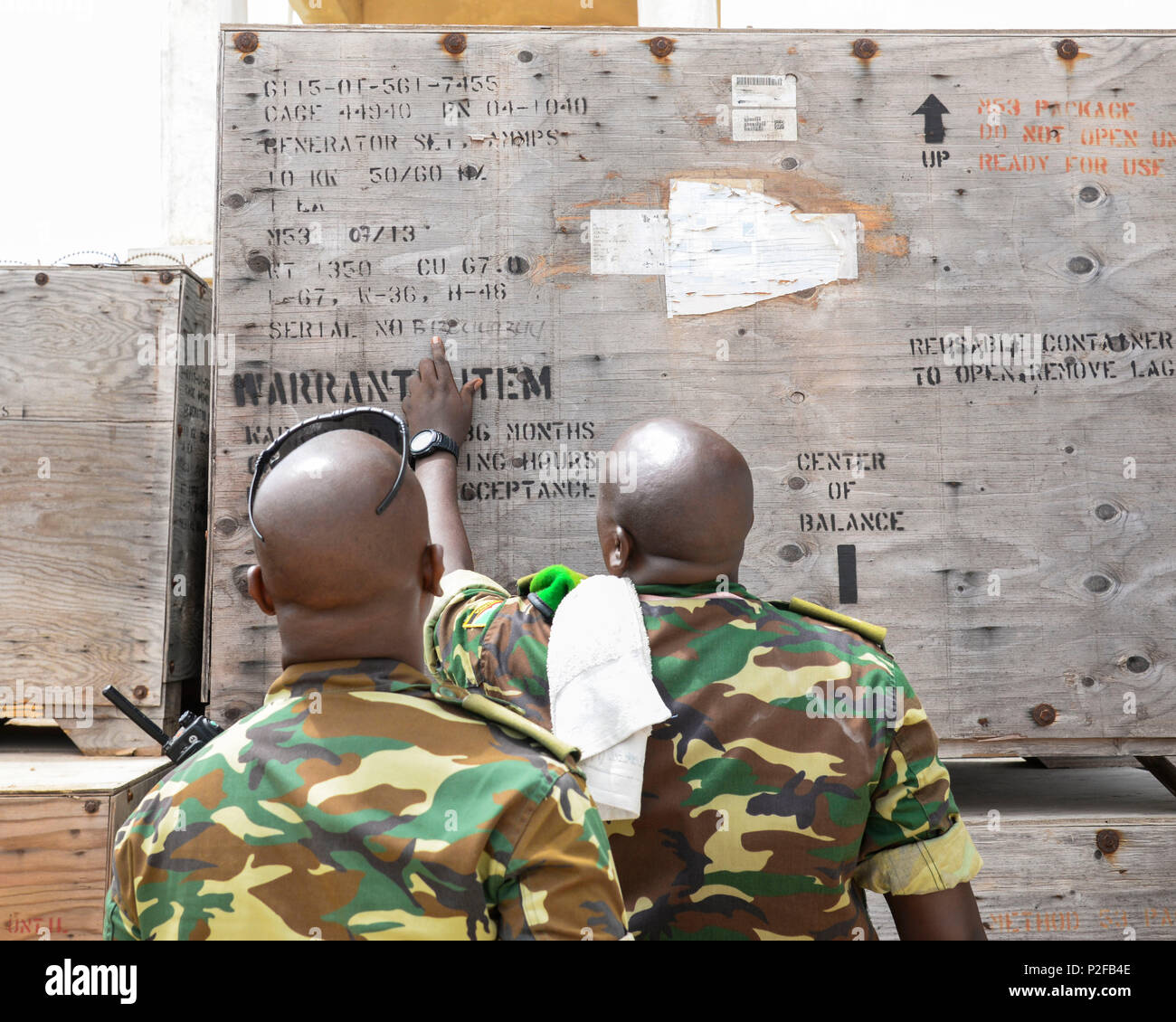 Soldiers from the Burundi National Defense Force verify a power